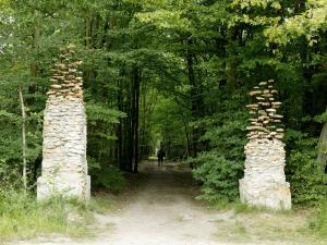Cornelia Konrads. The gate, 2004 stones, iron, cement. 3.5 high x 5 m long x 0.8 m wide. Fontainebleau (France). www.cokonrads.de