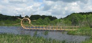 """Backflip Bridge"", 2009. Wood. 550 x 1850 x 80 cm. Picherande, Massif du Sancy, France."