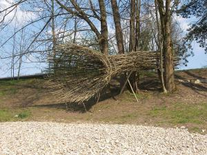 Roland Mayer. Observer, 2010 Saplings and branches, wire. Length 8 m. Mangfall river bank Rosenheim. www.mayerrolandart.de