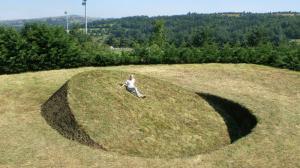 "Round Balance"". 2008. Soil, grass. 900 x 900 x 260 cm. Saint-Flour, France."