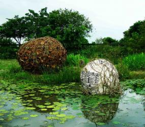 Ashish Ghosh. Warning for the Globe, 2009. Bamboo, cotton cloth, each 1m diameter. Taiwan. www.sculptorashishghosh.in