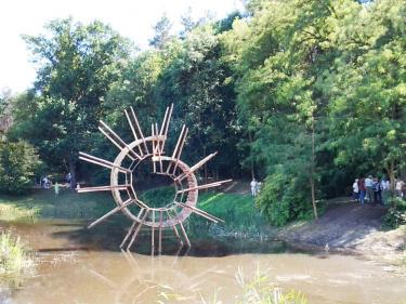 """Curl Up Bridge"", Poland 2018. Wood, 660 x 680 x 110 cm."