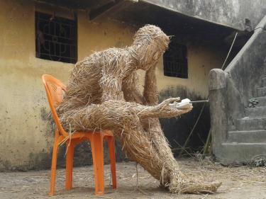"""""""Ecological man"""" ,India 2017. Rice straw, bamboo, chair, rope, telephone, 115 x 130 x 80 cm"""
