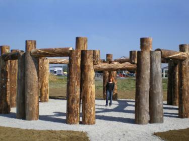 """""""Woodhenge"""", Austria 2007. Wood, iron, gravel height 320 diameter 1100 cm ."""